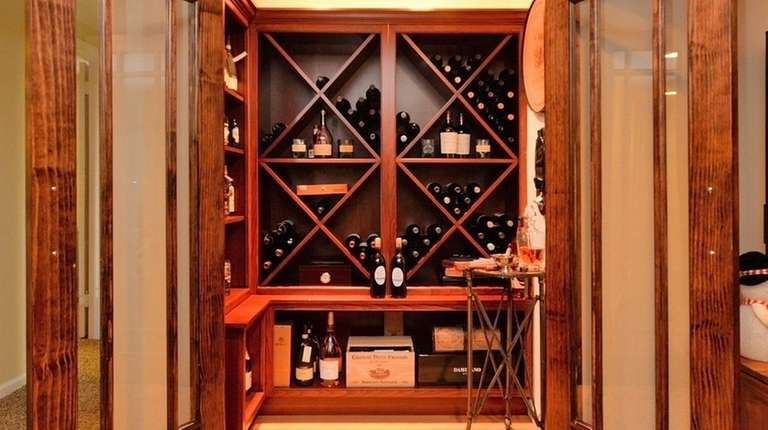 The wine room in this Glen Cove high-ranch