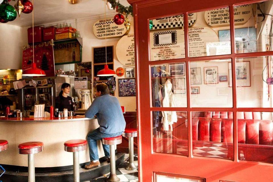A diner sits at the bar at Glen's