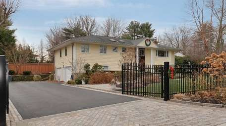 This four-bedroom Glen Cove high-ranch, listed for $948,000