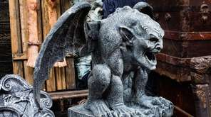 A giant stone latex gargoyle is among the