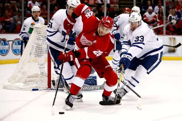 Brendan Smith of the Detroit Red Wings tries