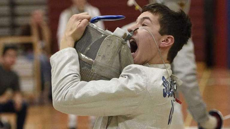 Ward Melville's Danny Solomon reacts after winning against