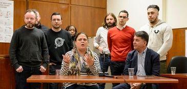 Juror Catryn Kiernan, center, speaks during a news