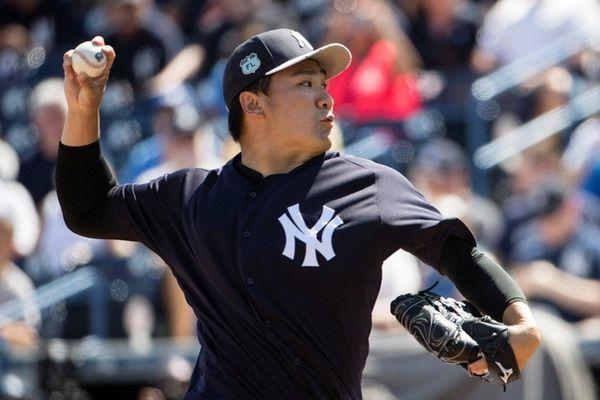 New York Yankees starting pitcher Masahiro Tanaka pitches