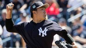 New York Yankees starting pitcher Masahiro Tanaka pitches