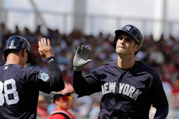New York Yankees' Greg Bird, right, high-fives teammate