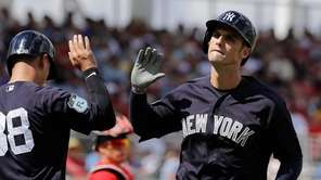 New York Yankees' Greg Bird, right, high-fives teammate