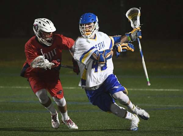 Hofstra attacker Ryan Tierney drives against his New