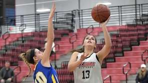 Mt. Sinai's Brooke Cergol (13) drives to the