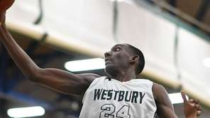 Isaiah Bien-Aise #24 of Westbury grabs a rebound