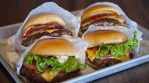 The Shackburger (foreground) and the Smoke Shack burger