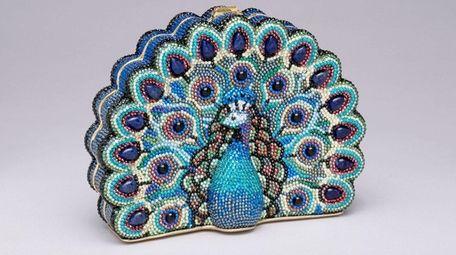 Judith Leiber's peacock-shaped rhinestone minaudière is the last