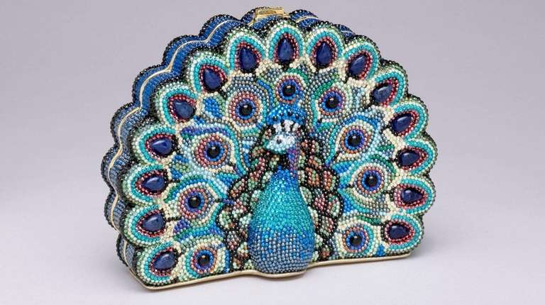 Judith Leiber's peacock-shaped rhinestone minaudière is the last
