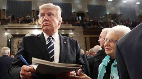 President Donald Trump leaves the House Tuesday night,