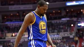 Golden State Warriors forward Kevin Durant walks to