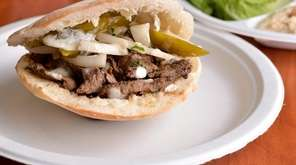 The lamb-beef shawarma sandwich, garnished with onions, pickles