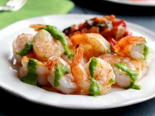 Simple seared shrimp drizzled with herb, olive oil,
