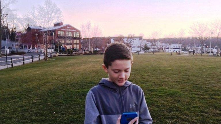 Kidsday reporter Brady DeWitt searches for Pokémon.