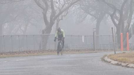 A man rides his bicycle at Heckscher State
