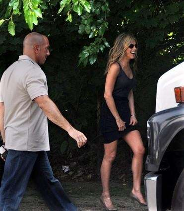 Jennifer Aniston arrives with her bodyguard the
