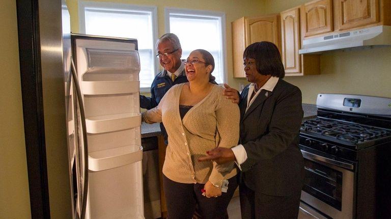 Navy veteran Jessica Lopez, center, looks around the