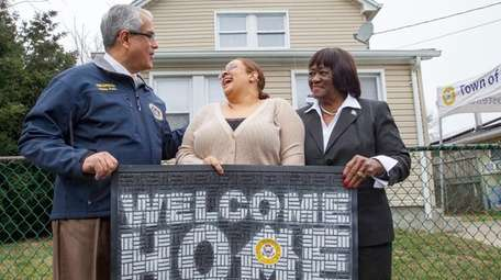 Navy veteran Jessica Lopez, center, received the keys