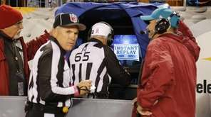 NFL referee Walt Coleman, center, enters the instant