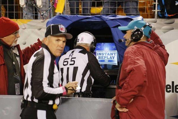 NFL referee Walt Coleman, center, enters the instant