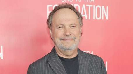 Billy Crystal attends the grand opening of the