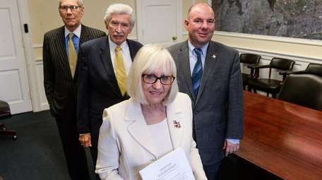North Hempstead Town Supervisor Judi Bosworth, center, with