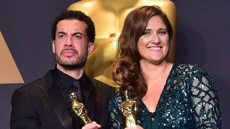 Director Ezra Edelman and producer Caroline Waterlow pose