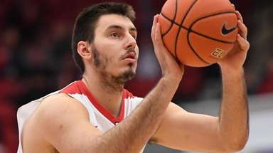 Stony Brook forward Jakub Petras shoots a free