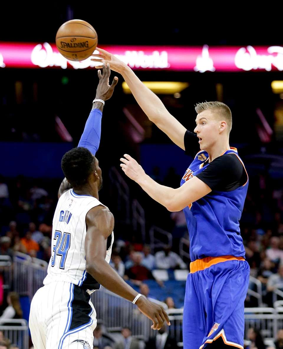 New York Knicks' Kristaps Porzingis, right, passes the