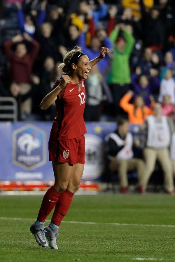 The United States' Lynn Williams celebrates after scoring