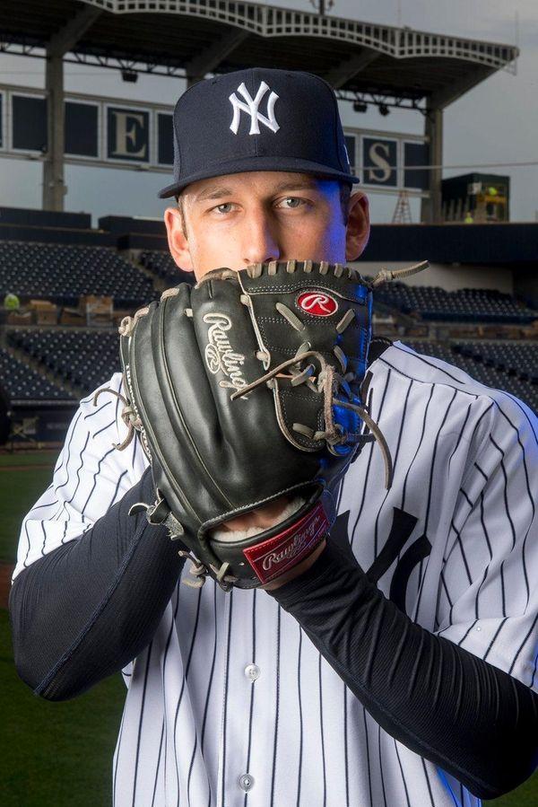 New York Yankeespitcher James Kaprielian poses during photo