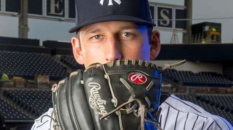 New York Yankees pitcher James Kaprielian poses during photo
