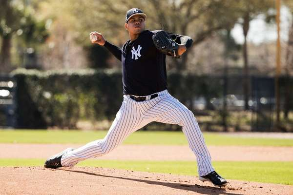 New York Yankees pitcher Dellin Betances pitches ahead