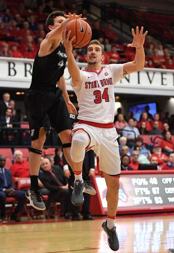 Stony Brook guard Lucas Woodhouse puts up a