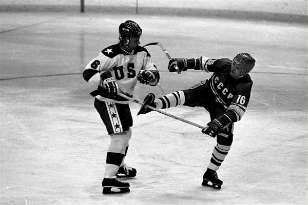 Soviet forward Vladimir Petrov is trapped by stick