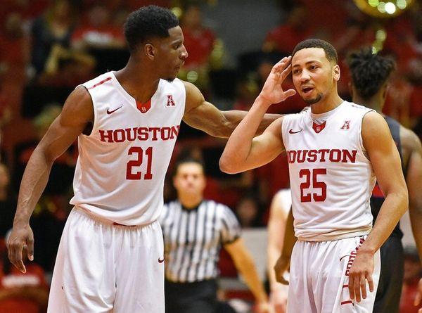 Houston guard Damyean Dotson talks with guard Galen