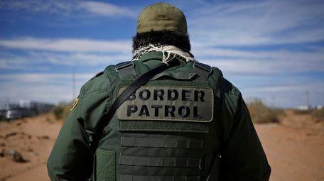 A U.S. Border Patrol agent keeps watch along