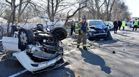 Emergency personnel respond to a two-vehicle crash on