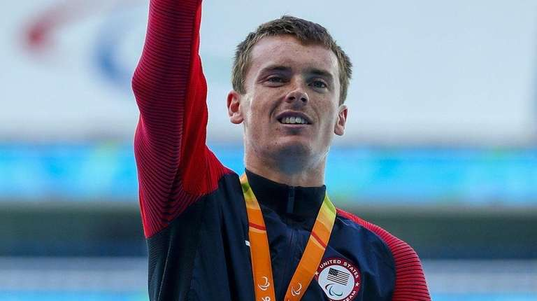Gold-medalist Mikey Brannigan of East Northport celebrates after