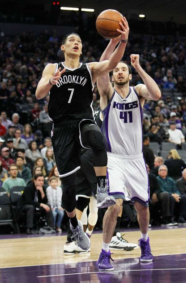 Brooklyn Nets guard Jeremy Lin drives to the
