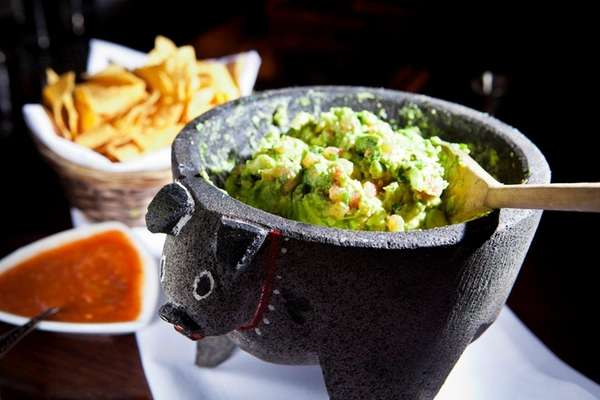 Table-side guacamole is served at Besito in Huntington.