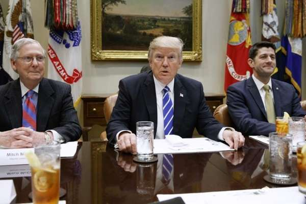 President Donald Trump, flanked by Senate Majority Leader