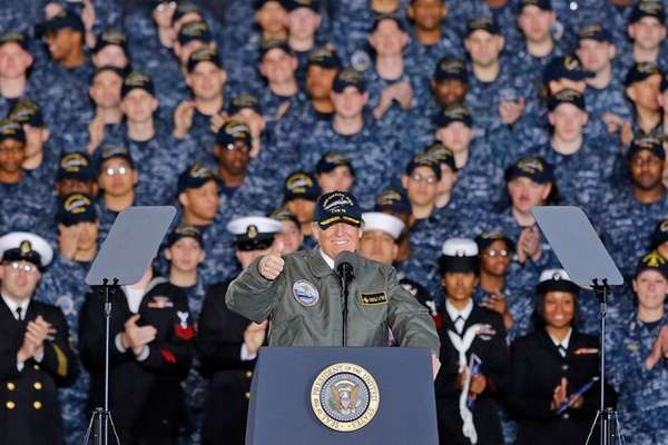 President Donald Trump speaks abroad the aircraft carrier