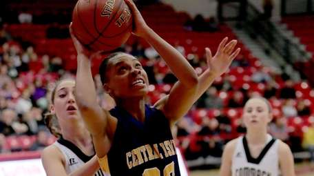 Central Islip forward Anhya Jenkins (23) gores for