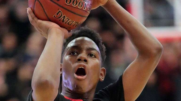 Hills East's Savion Lewis shoots from the foul