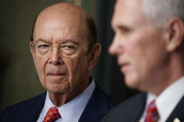 New Commerce Secretary Wilbur Ross listens is introduced